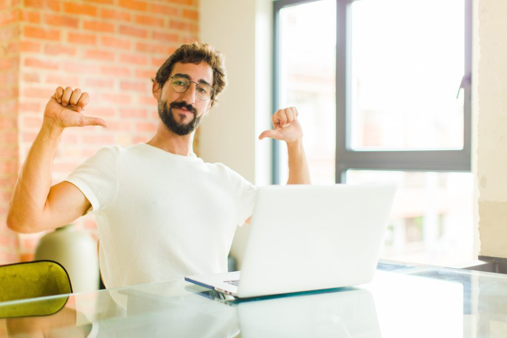 man looking smug about his website he's built himself