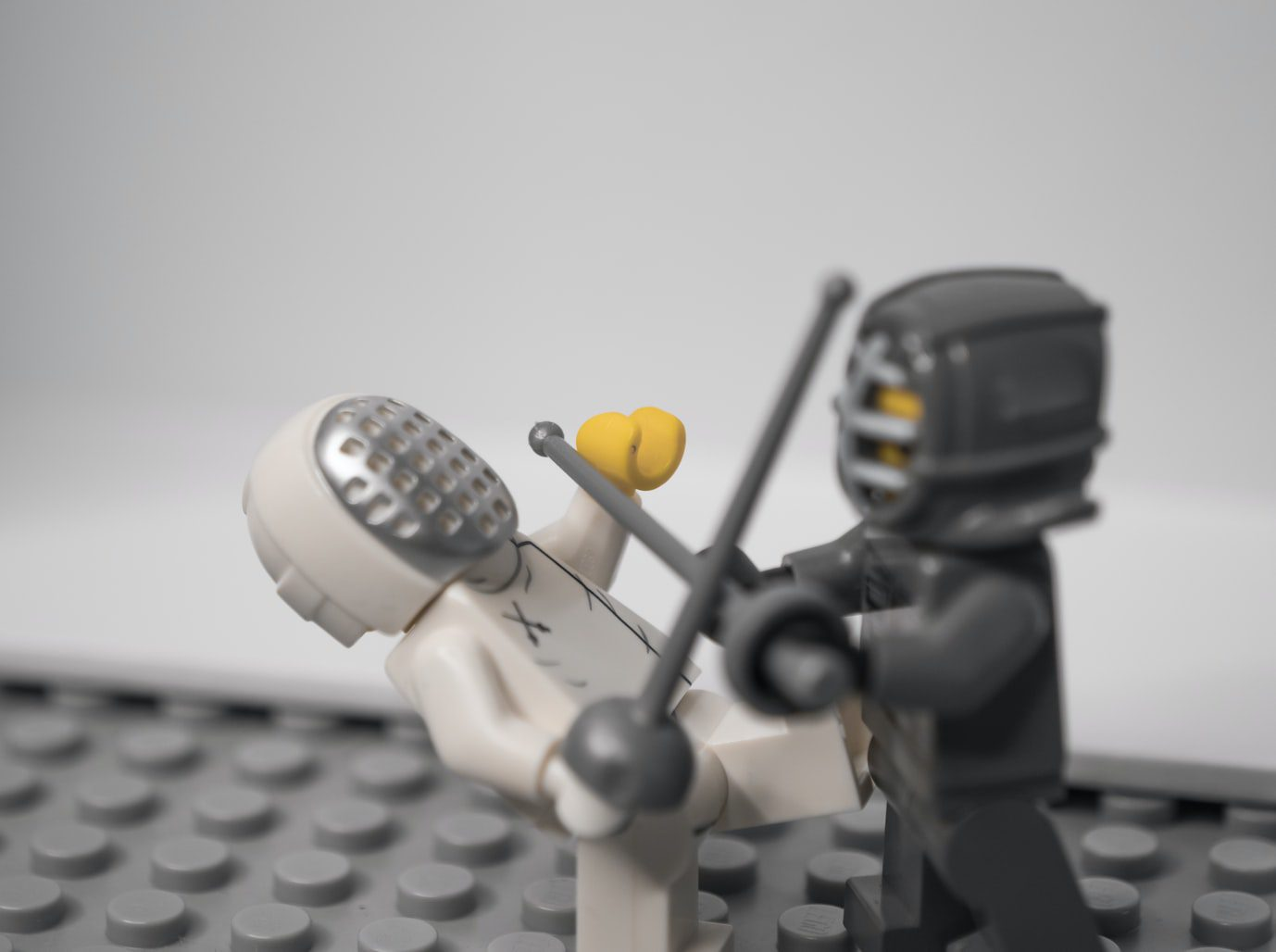 two figures battling it out to demonstrate the direct hire vs hiring a digital marketing agency