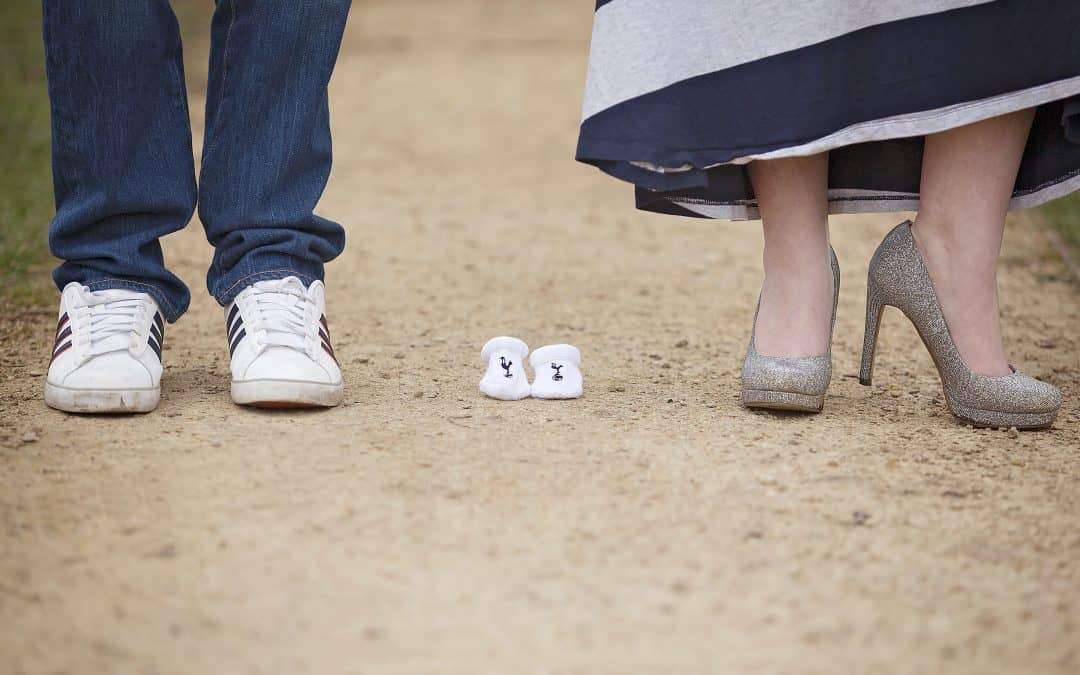 mum and dad with baby booties maternity photoshoot outfit idea